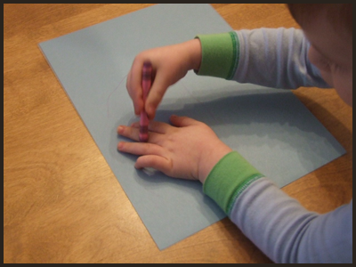 Have Your Child Trace His Hand on the Colored Construction Paper