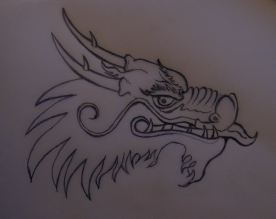 step by step how to draw a dragon head
