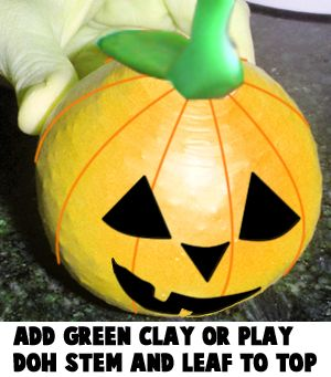 Add green clay or play doh stem and leaf to top