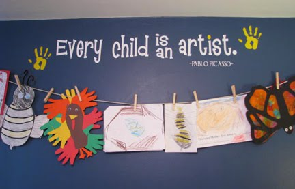 Hang childs artwork with clothespins