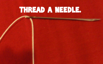 Thread a needle.