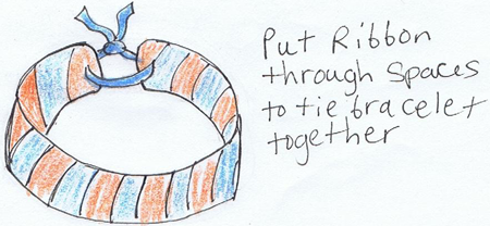 Put ribbon through spaces to tie bracelet together.