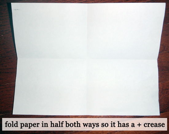 Fold paper in half both ways.