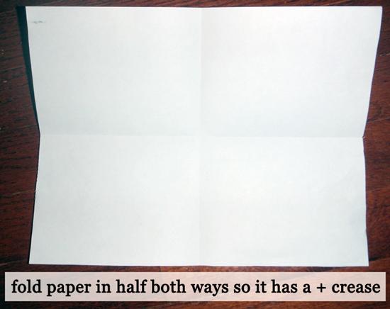 Fold paper in half both ways.