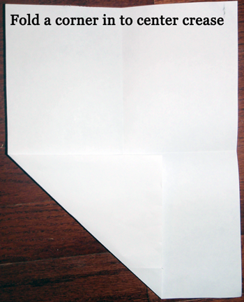 Fold a corner into center crease.