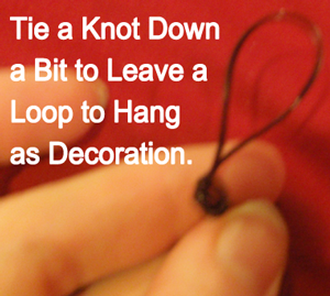 Tie a knot down a bit to leave a loop to hang as decoration.