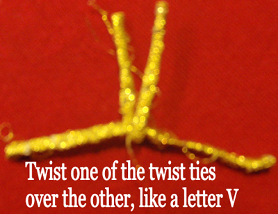 Twist one of the twist ties over the other, like a letter V.