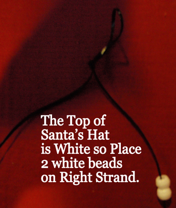 place 2 white beads on right strand.
