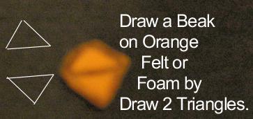 Draw a beak on orange felt or foam