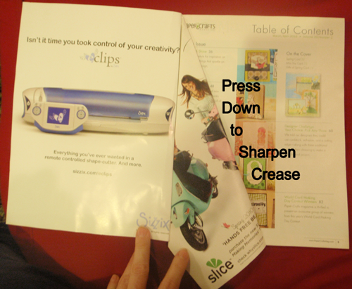 Press down to sharpen crease.