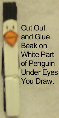 Cut out and glue beak on white part of penguin