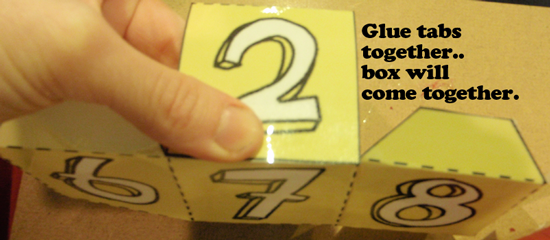 Glue tabs together.