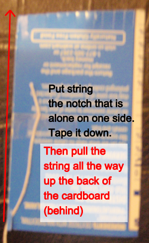 Put string in the notch that is alone on one side.