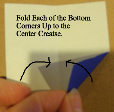 Fold each of the bottom corners up to the center crease.