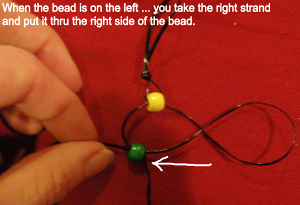 take the right strand and put it thru the right side of the bead.