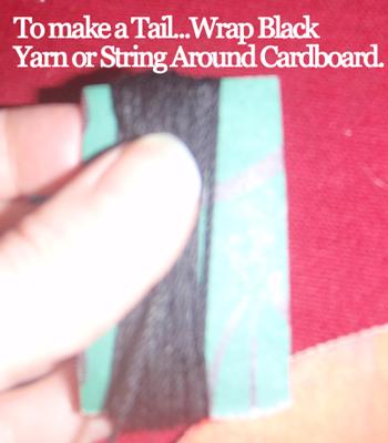 Wrap black yarn or string around cardboard.