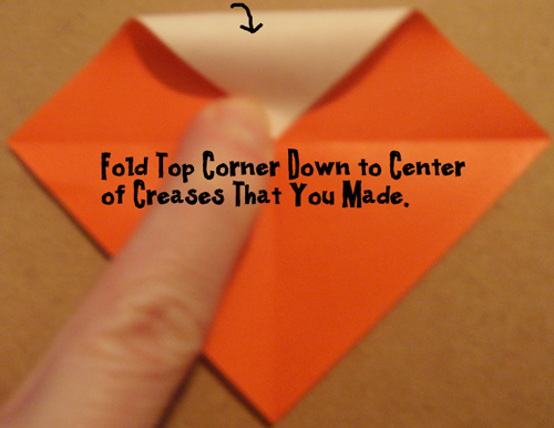 Fold top corner down to center of creases that you made.