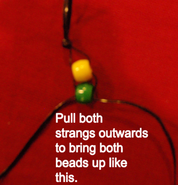 Pull both strands outwards to bring both beads up