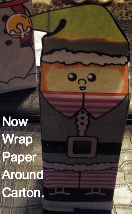 Now wrap paper around carton.