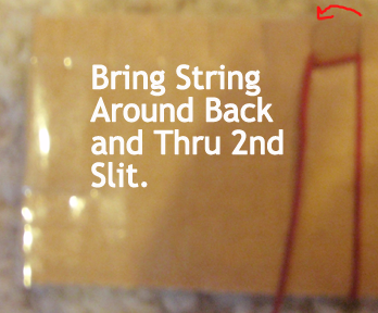 Bring string around back and thru second slit.