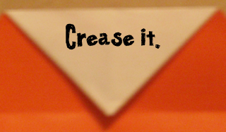 Crease it.