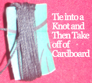 Tie into a knot and then take off of cardboard.