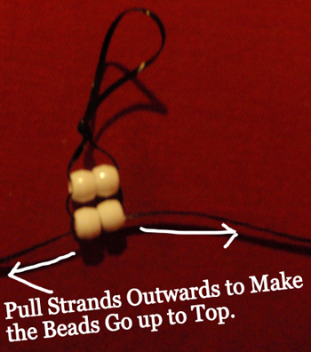 Pull strands outwards to make the beads go up to the top.