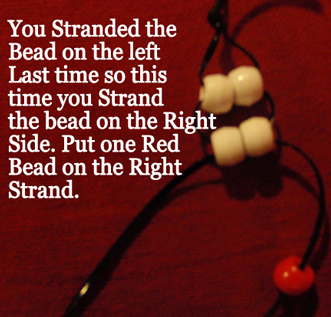 Put one red bead on the right strand.