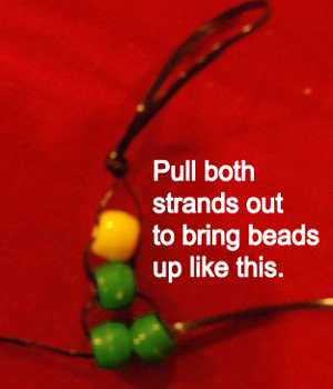 Pull both strands out to bring beads up