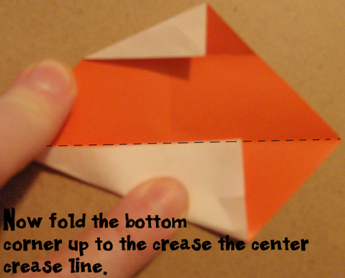 Fold the bottom corner up to crease the center crease line.