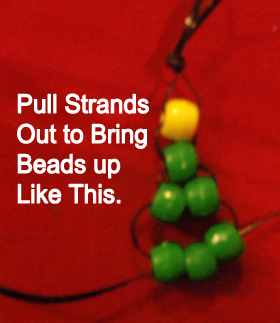 Pull strings out to bring beads up like this.