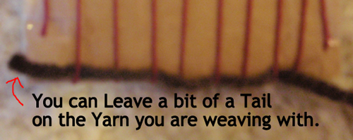 You can leave a bit of a tail on the yarn you are weaving with.