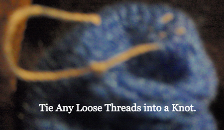 Tie any loose threads into a knot.