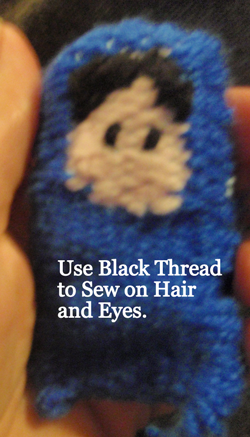 Use black thread to sew on hair and eyes