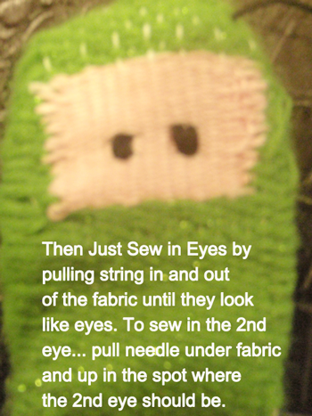 just sew in eyes by pulling string in and out of the fabric until they look like eyes.