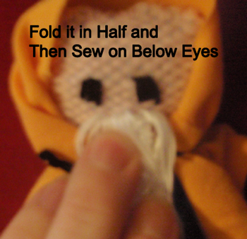 Fold it in half and then sew it on below the eyes.