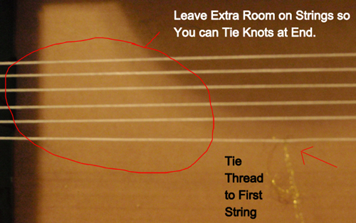 Tie thread to first string.