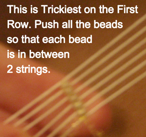 Push all the beads so that each bead is in between 2 strings.