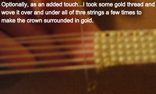 I took some gold thread and wove it over and under all of the strings a few times
