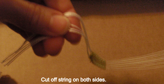 Cut off string on both sides.