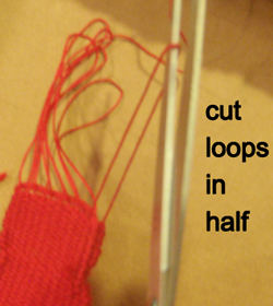 Cut loops in half.