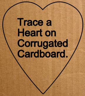 Trace a heart on corrugated cardboard.