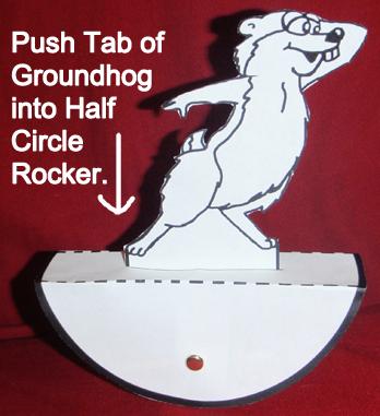 Push tab of groundhog into half circle rocker.