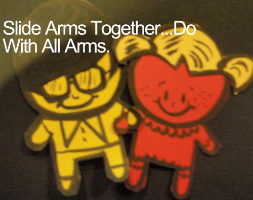 Slide arms together.