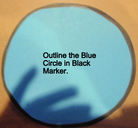 Outline the blue circle in black marker.