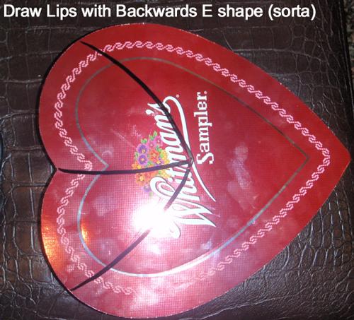 Draw lips with backwards E shape.
