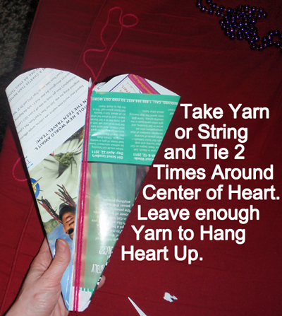 Take yarn or string and tie 2 times around center of heart.