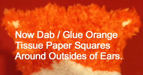 Now dab / glue orange tissue paper squares around outside of ears.