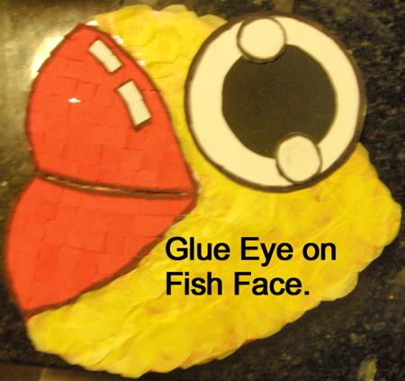 Glue eye on fish face.