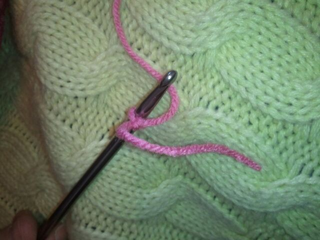 Knot yarn on crochet hook to begin.